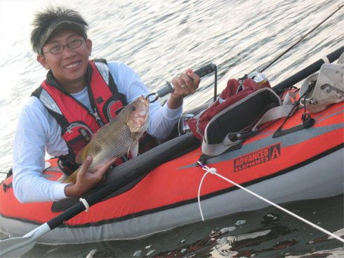Ang Cho on Kayak